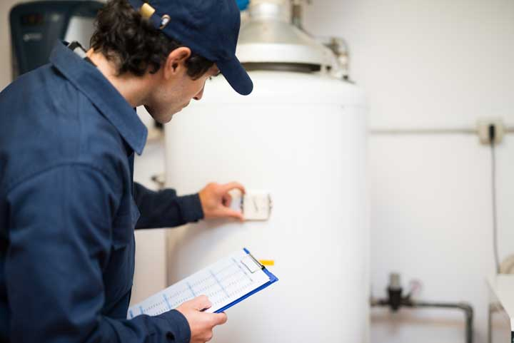 Water Heater Contractor Performing Water Heater Installation